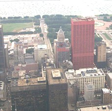 A view east from the Sears Tower Skydeck. The road running vertically in the image all the way to the Lake Michigan Shore is Jackson Boulevard, US 66. Westbound 66, Adams Street, is seen running vertically at the lower left edge of the image.